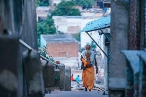 Guru Walking Up The Steps