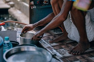 Indian Man Washing His Chai Pan