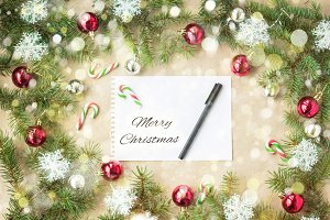 Merry Christmas and New Year typographical on holiday background with Xmas decoration, branch of fir tree and snow
