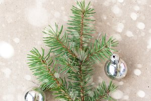 Christmas tree made of fir branches and silver decorations with snow. Christmas, winter, new year concept.