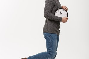 Rush time concept - Young beard smart man running with clock in busy moment over white studio.