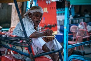 Rickshaw Driver Eating Lunch