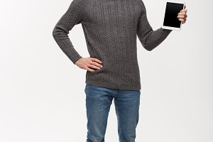 Holiday and Business Concept - Young handsome man looking and showing tablet display for presenting.