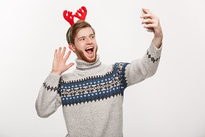 holiday and lifestyle concept - Young handsome beard man taking a selfie or talking facetime with friend.