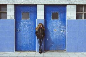 girl in blue wall
