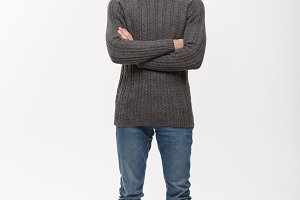 Holiday Concept - Young beard man in sweater crossed arms posing on white background.