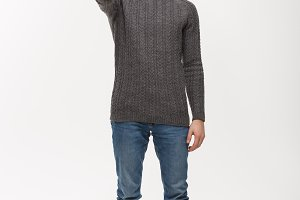 Holiday Concept - Young beard man in sweater giving thumb up to camera.