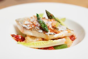 Grilled fish fillet with asparagus