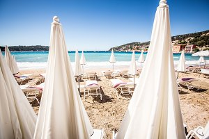White Parasols At The Beach