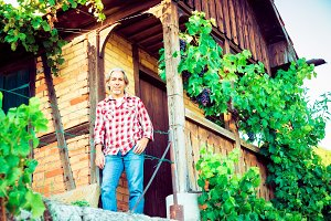 Winemaker Standing By His Cottage