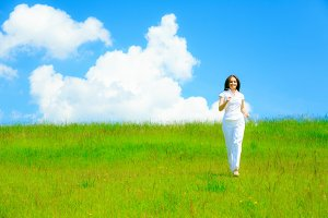 Woman Running On Green Meadow