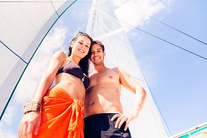 Young Couple On Sailboat
