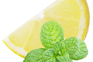 Slice lemon fruit with mint leaves