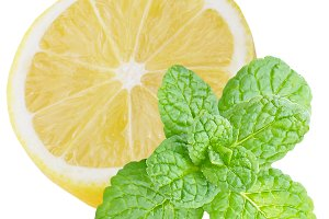 Isolated half lemon with mint leaves