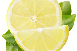 Half and slice of lemon with leaves