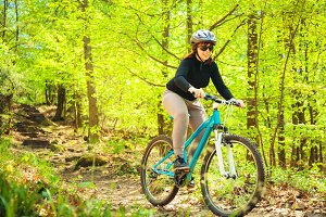 Young Woman Riding Her Mountain Bike