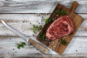 Knife with raw Steak