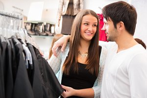 Girl And Her Boyfriend Are Shopping For Clothes