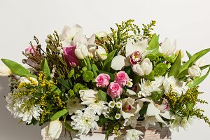 arrangement of flowers from roses, orchids and tulips
