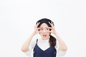 Amazed and surprised female person putting fingers around eyes wide open in white isolated background