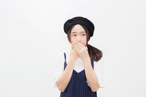 Asian female person covering her mouth in white isolated background
