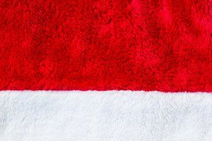 Close up red and white Santa Claus hat texture to backround