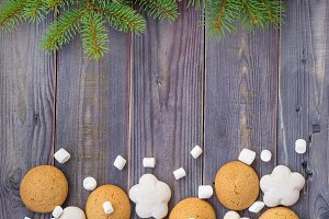 Christmas border with gingerbread, marshmallow and branch of fir tree