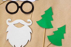 Photo booth colorful props for christmas party - mustache, santa claus, fir tree, glasses, hat