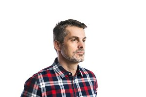 Mature hipster man in checked shirt. Studio shot, isolated.