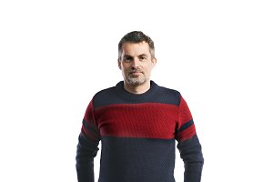 Mature hipster man in woolen sweater. Studio shot, isolated.