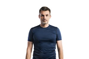 Mature hipster man in blue t-shirt. Studio shot, isolated.