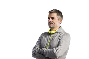 Mature hipster man in gray sweatshirt. Studio shot, isolated.