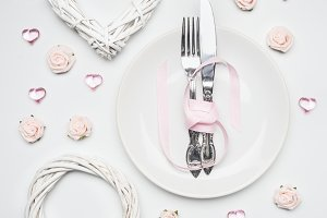 knife and fork tied with ribbon