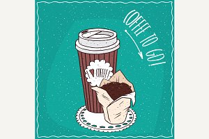 Paper cup of coffee with cake