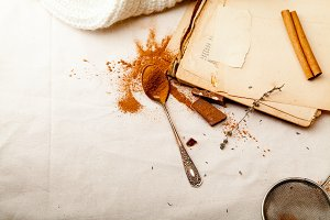 Tea spoon with spilled cocoa powder