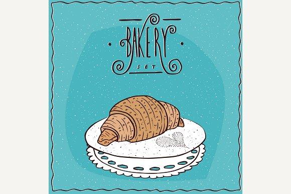 Perfect Croissant Lie On Lacy Napkin