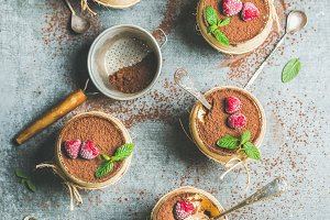 Homemade Italian dessert Tiramisu in glasses with fresh mint leaves