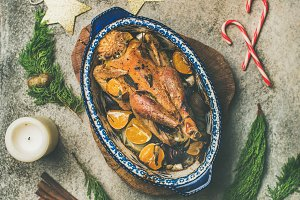 Roasted chicken for Christmas celebration table over grey background
