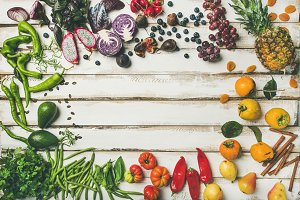 Flat-lay of fresh fruit, vegetables, greens and superfoods