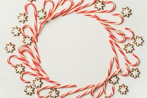 Christmas wreath pattern made from candy cane sticks, square crop