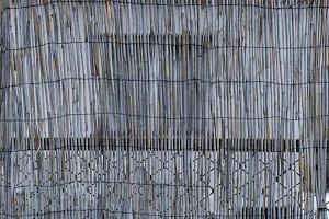 A gray cane fence