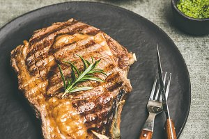 Grilled hot rib-eye beef steak with red wine