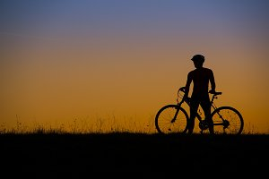 Young man on the bicycle.