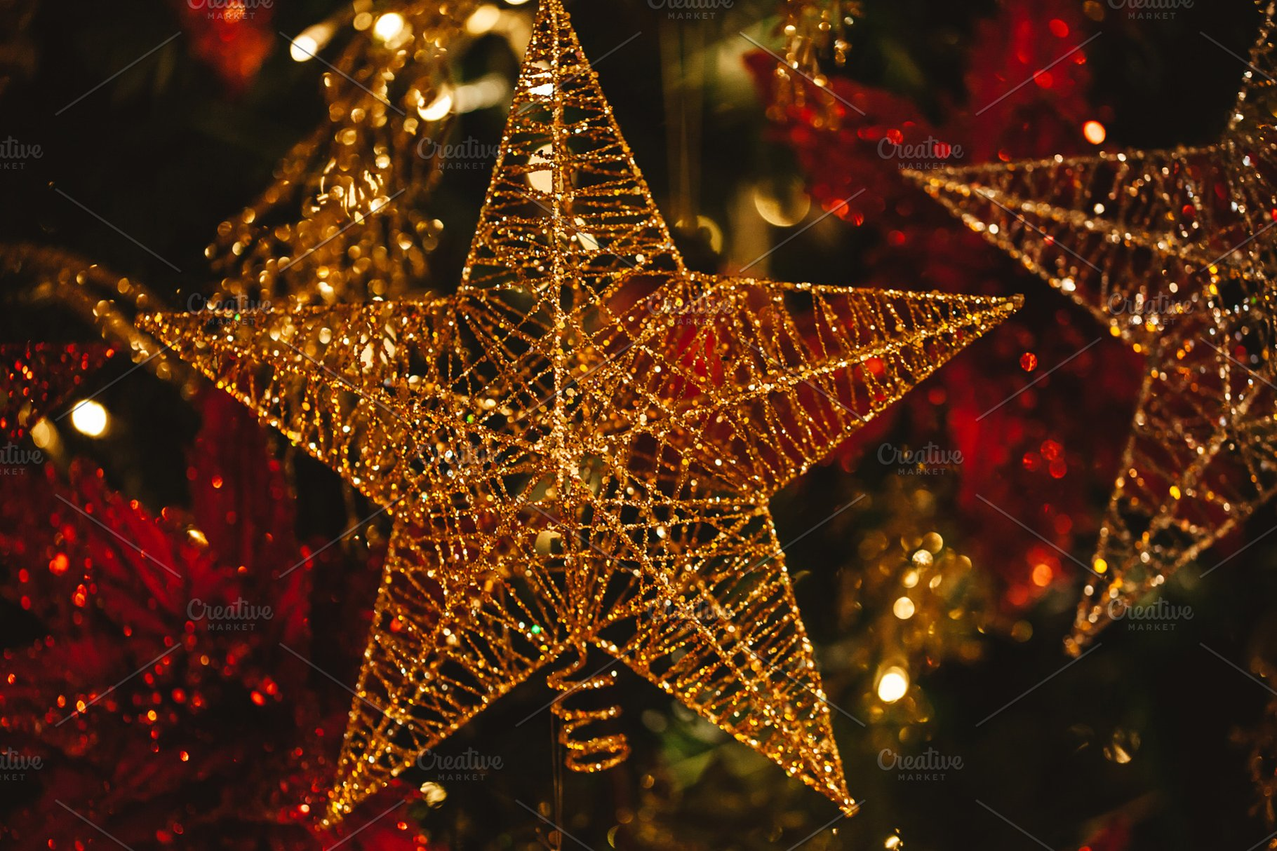 Close Up Of Golden Christmas Detailed Glittering Star Hanging On Christmas Tree