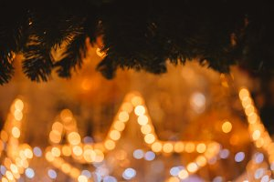 Blurry golden bokeh light background in glowing star shape of lights - defocused image intended