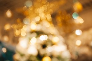 Gold shiny abstract blurred bokeh used for holiday or Christmas background