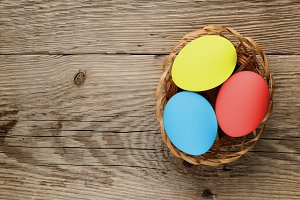 Easter eggs on wooden table top view