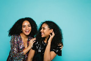 Laughing young women in studio
