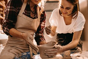 Two women at a pottery workshop