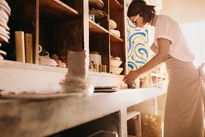 Female potter working with clay